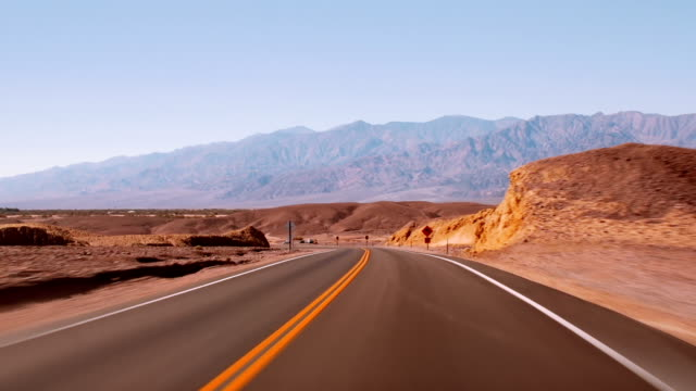 Driving on Highway 190, time lapse Driving on Highway 190 through Death Valley National Park, time lapse. Desert landscape. mojave desert stock videos & royalty-free footage