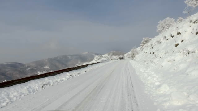 Driving POV on mountain road after heavy snowfall video