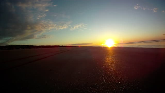 HD: Driving On The Beach At Sunset video