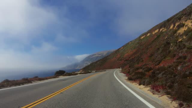 vídeos de stock e filmes b-roll de pov driving on the big sur coast, california - big sur