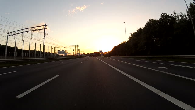 stockvideo's en b-roll-footage met driving on the highway with gopro camera mounted - schiphol