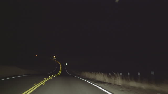 Driving on the night's road in California. Driver's point of view Driving on the night's road in California, USA, North America. Driver's point of view. 4K UHD video footage. country road stock videos & royalty-free footage