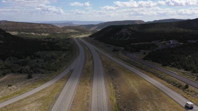 RV Driving on Utah Freeway Aerial Drone Shot RV Driving on Utah Freeway Aerial Drone Shot towing stock videos & royalty-free footage