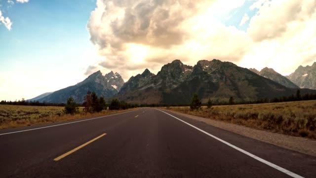 stockvideo's en b-roll-footage met rijden op wyoming het grand teton national park - twilight