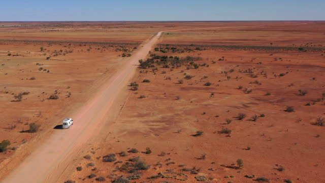 Driving outback Driving in the far outback of Queensland, Australia. australia stock videos & royalty-free footage