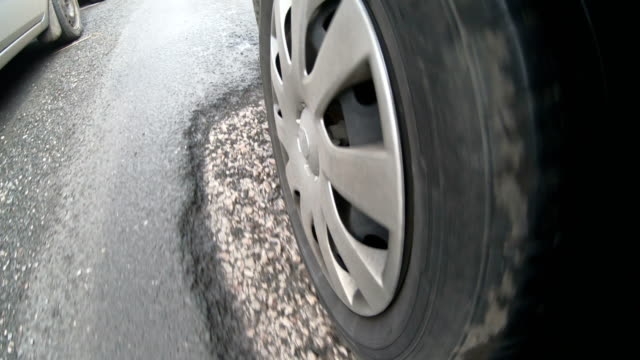 4K: Driving over Potholes in damaged road, view from the Tyre video