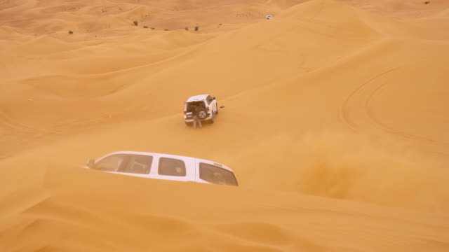 SLO MO Driving over sand dunes video