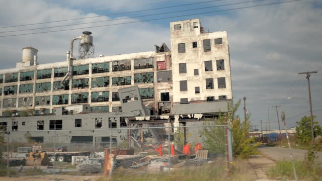 CLOSE UP: Driving past a abandoned and demolished industrial building in Detroit video