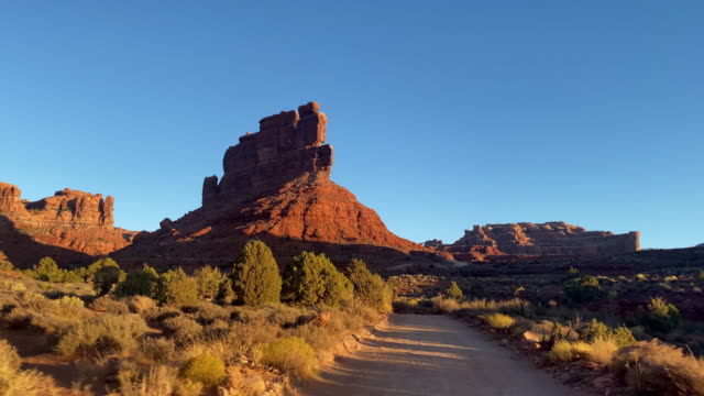 Driving past the rock formations of the Valley of the Gods