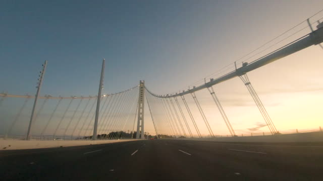 Driving Perspective Bay Bridge Eastern Span Stock 4k resolution UHD video of vehicle driving across the western span of the Bay Bridge into San Francisco. western usa stock videos & royalty-free footage