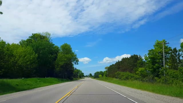 Driving Rural Countryside During Bright Summer Day.  Driver Point of View POV Along Beautiful Sunny Country Road. Driving Rural Countryside During Bright Summer Day.  Driver Point of View POV Along Beautiful Sunny Country Road. country road stock videos & royalty-free footage