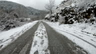 istock Driving slow and cautious on the snowy frozen rural road 1199083358