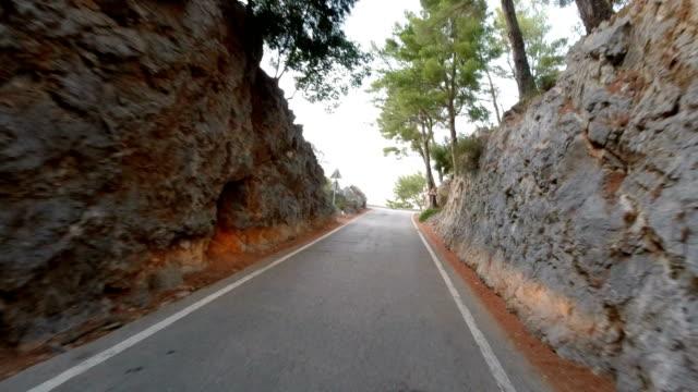 Driving through a narrow pass between the mountains in Majorca