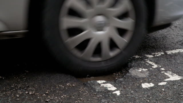 4K: Driving through a Pothole on a damaged Road / Highway video
