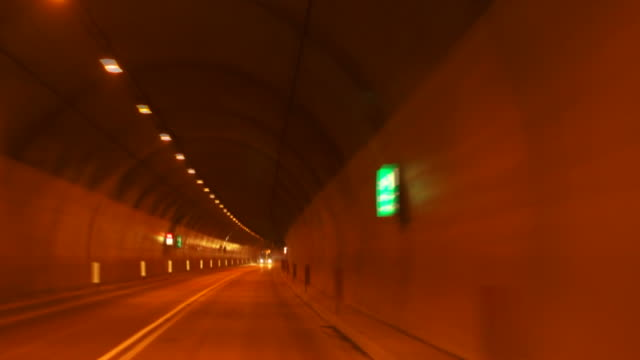 HD Driving through Alpine Road Tunnels TL Time lapse car point of view shot of driving through Alpine road tunnels in winter.   Shot with LEICA Summilux-R 35mm f/1.4 lens. sicherheit stock videos & royalty-free footage