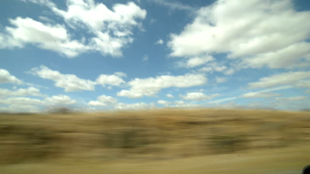 Driving through beautiful South Africa landscape, daytime, with amazing cloudy sky video