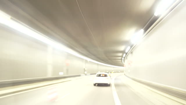 Driving Through City Road Tunnel At Night Time Lapse video