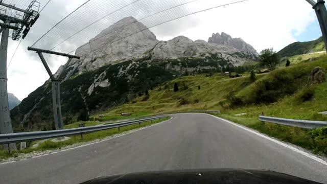 Driving through Fedaia Mountain Pass. Dolomites, Italy video