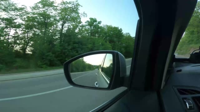 Driving through of a small town A small town in Eastern Europe, driving through a small province rear view mirror stock videos & royalty-free footage