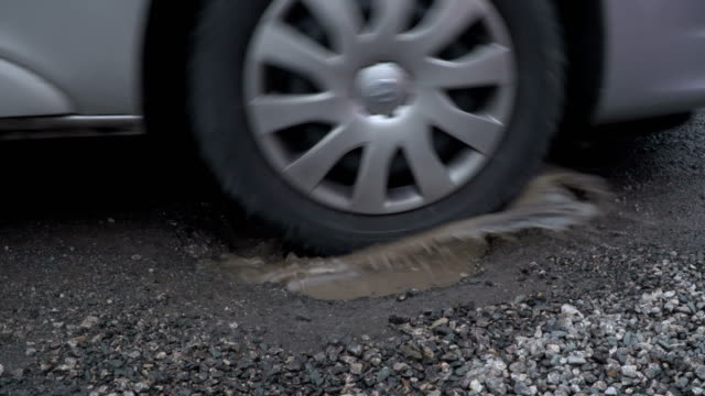 4K: Driving through Pothole on Road / Street video