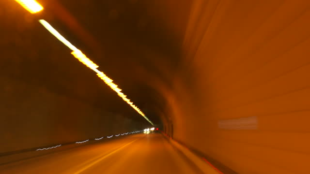 HD Driving Through Road Tunnel Time Lapse Time lapse car point of view shot of driving through Alpine road tunnel in winter.   Shot with LEICA Summilux-R 35mm f/1.4 lens. sicherheit stock videos & royalty-free footage