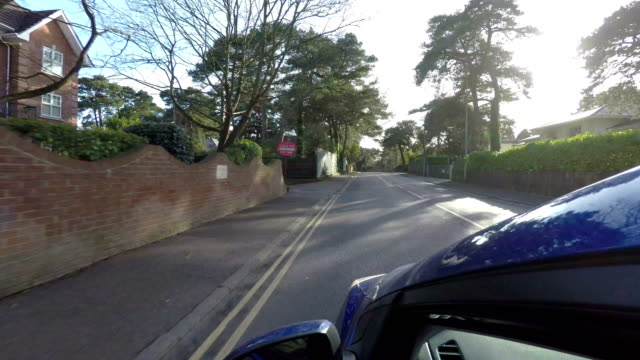 Driving through suburbia in UK town of Poole video