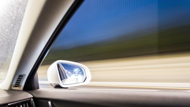 t/l pov driving through urban street - self driving cars stock videos & royalty-free footage
