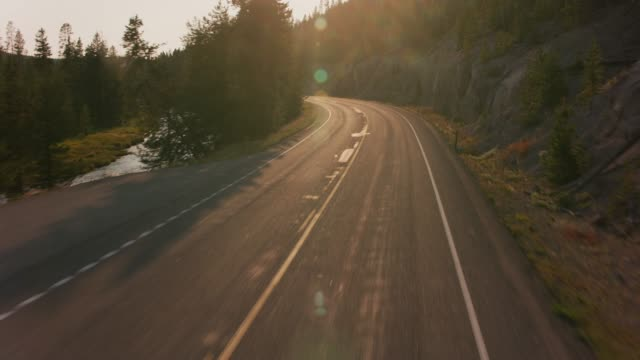Driving through Yellowstone National Park at sunset. video