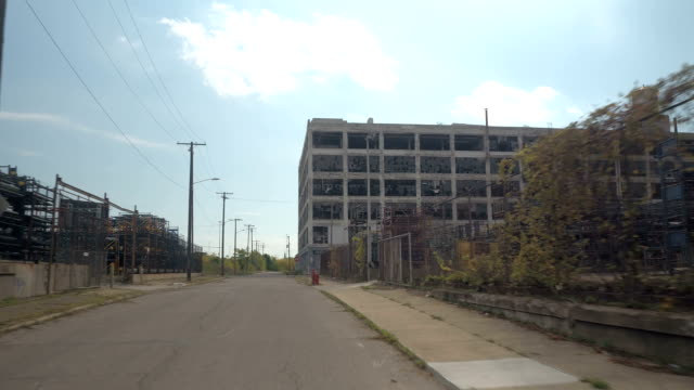 CLOSE UP: Driving towards the ruins of abandoned Fisher Body Plant 21 in Detroit video