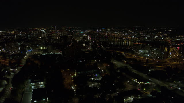 Drone aerial at night panning downtown Portland Oregon  including the Tilikum Bridge and the towers over the convention center video