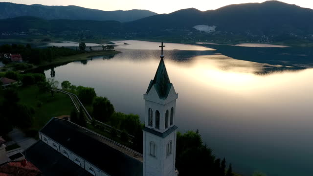 Drone aerial circular view of the Rama Scit church tower in Franciscan monastery, video