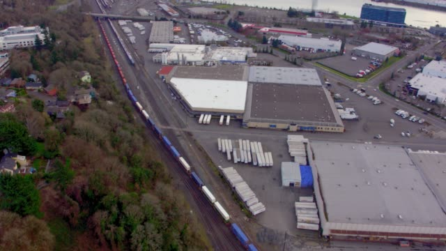 Drone aerial dolly style flyover of a colorful train pulling into the Union Pacific Train yard in Portland Oregon on a winter day video