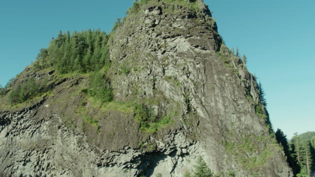 Drone aerial flyby moving right of Beacon Rock and the Columbia River on a blue sky sunny day video