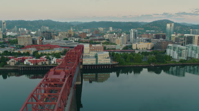Drone aerial flyover at twilight of the Broadway Bridge pannig to reveal downtown Portland on a summer morning video