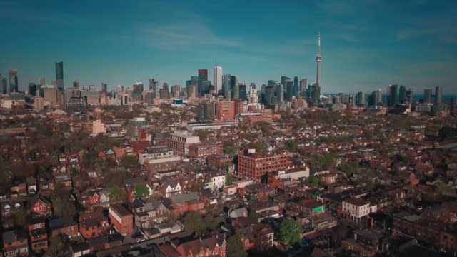 drone aerial looking at downtown of large city - toronto architecture stock videos & royalty-free footage