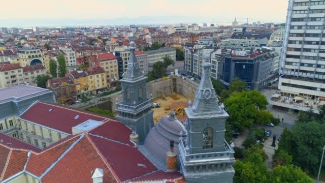drone aerial shot of city construction site in business district sofia, bulgaria - bułgaria filmów i materiałów b-roll