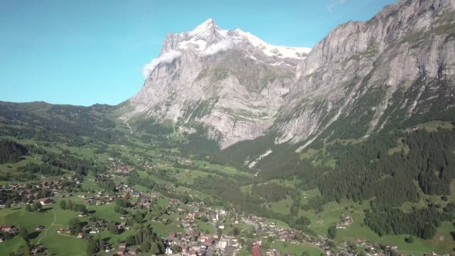drone aerial shot of grindewald in a beautiful day in the swiss alps, in switzerland - base jumping video stock e b–roll