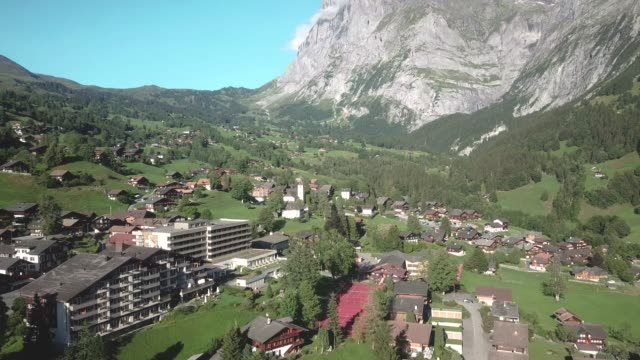 Drone Aerial shot of Grindewald in a beautiful day in the swiss alps, in Switzerland video