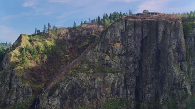 Drone aerial tracking shot moving right of the massive moss covered cliffs at Crown Point in the Columbia River Gorge video