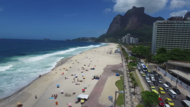 Drone aerial view from a mountain beach on Brazilian atlantic coast border with city builders video