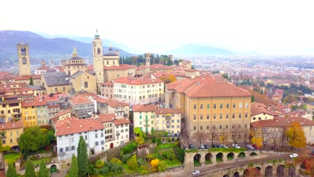 drone aerial view of famous old town bergamo bergamo is a northern italy treasure view from above with cityscape and landscape of italy - lombardia video stock e b–roll