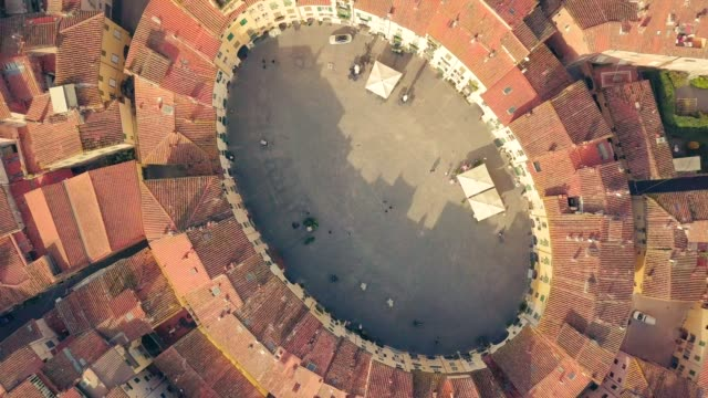 drone aerial view of piazza dell' anfiteatro in lucca italy piazza dell'anfiteatro is a public square in the northeast quadrant of walled center of lucca - italian architecture stock videos & royalty-free footage