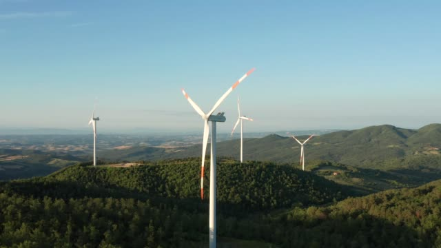 drone aerial view of wind turbine in the country - turbina a vento video stock e b–roll