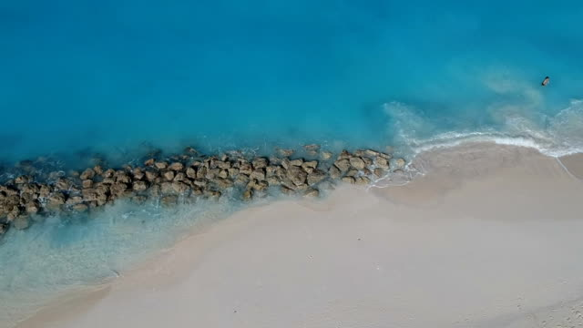Drone ascending aerial of jetty in Grace Bay, Providenciales, Turks and Caicos Drone stationary aerial of pier in Grace Bay, Providenciales, Turks and Caicos turks and caicos islands stock videos & royalty-free footage