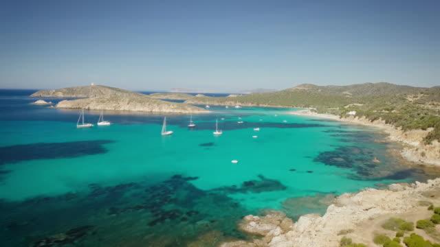 drone bird view of mediterranean sea by sardinia italy. summer vaction - sardegna video stock e b–roll
