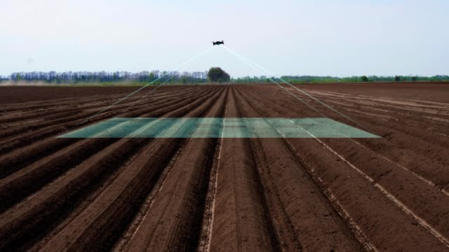 UAV drone, copter with digital camera flies over, scanning newly plowed agricultural field, Smart agriculture. concept of Modern agriculture, industrial revolution - vídeo