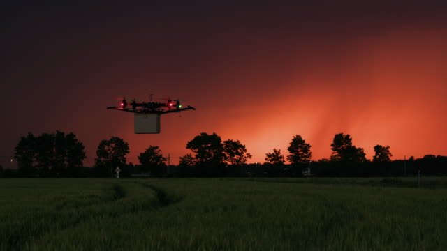 WS Drone delivering a package at dusk video