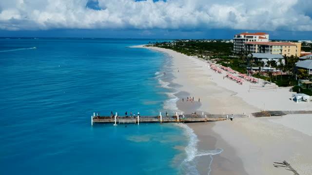 Drone descending aerial of pier in Grace Bay, Providenciales, Turks and Caicos Drone descending aerial of pier in Grace Bay, Providenciales, Turks and Caicos. turks and caicos islands stock videos & royalty-free footage
