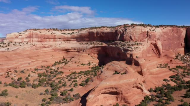 Drone Flies Near Orange Smooth Stone Massive Rock Formations In Desert Of Usa