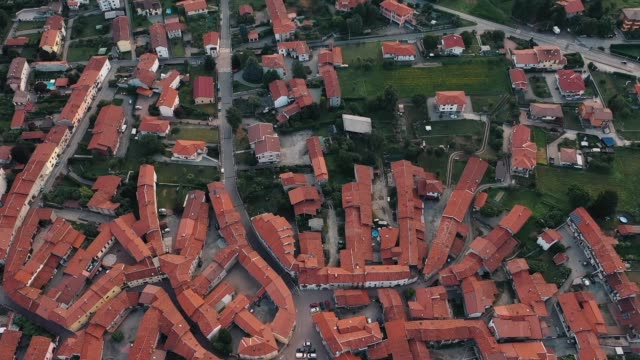 Drone flies over medieval town in Italy
